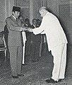 Ambassador John M. Allison meeting President Sukarno, Aneka Amerika 102 (1957), p1.jpg