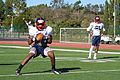 Anthony Averette, a defensive-back with the East Coast team for the Semper Fidelis All-American Bowl, completes a pass during his fourth practice in Fullerton, Claif 130103-M-EK802-526.jpg