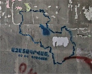 "United Armenia - A graffiti in Yerevan of the map outline of Armenia and Nagorno-Karabakh. The text reads ""Liberated, not occupied."""
