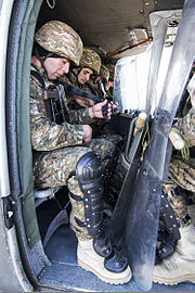 Armenian riot control soldiers buckle up on a U.S. Army UH-60 Black Hawk helicopter during a training exercise March 12, 2014, at Camp Bondsteel, Kosovo 140312-A-QK348-026.jpg