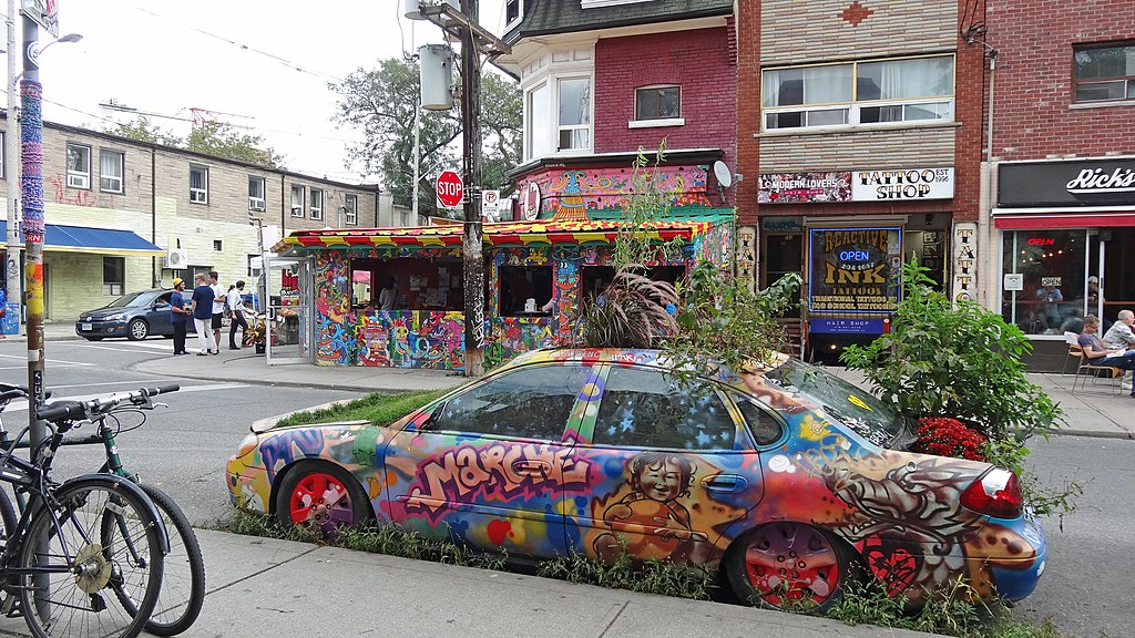 the garden car covered in graffiti art on a street in kensington market, Toronto