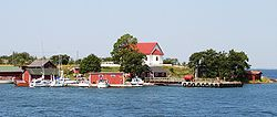 A view of Aspö from the sea. The white building on the top of the hill is the chapel
