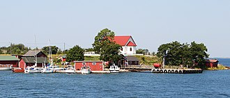 Aspö - A view of Aspö from the sea. The white building on the top of the hill is the chapel