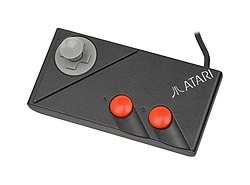The gamepad of the Atari 7800 with the thumbstick screwed in.