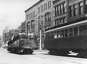 Transportation in Vancouver - Open and enclosed BC Electric streetcars in 1910 on Granville Street