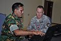 Bangladesh army Lt. Col. Zafor Mohammed Salahuddin, left, briefs U.S. Army Lt. Col. Justin Pickett, from U.S. Pacific Command, on scenario procedures during a Pacific Endeavor workshop Aug. 23, 2010, in Changi 100823-N-GM188-032.jpg