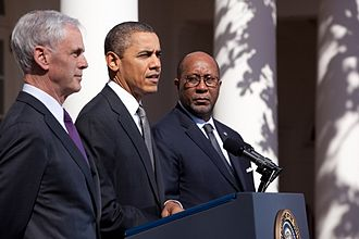 John Bryson - Then-Secretary Bryson, along with President Barack Obama and U.S. Trade Representative Ron Kirk at a press conference in the rose garden of the White House in March 2012.