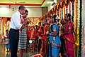 Barack and Michelle Obama greet young Indian dancers.jpg