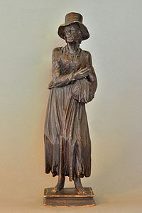 Beggar woman holding a bag carved in swiss pine from Gröden end 18th/beginning 19th century