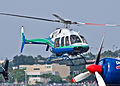 Bell 407 Helicopter taking off (6268281521).jpg