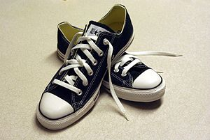 English: A pair of black Converse sneakers