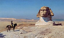 Painting of a man alone on a horse in front of the Great Sphinx in the midst of the desert.