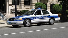 Old Proby's Garage Sektornein Police car with blue and gray stripes down the middle