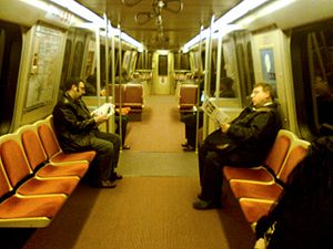 Washington Metro rolling stock - Breda 3283 with modified floor plan. Note the side-facing bench seats in the center, the strap handles along the ceiling, and the lean rests near the end of the car.