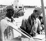 Bush Field - Flight Instructor and Aviation Cadet filling out Forms.jpg