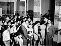 """CITIZENS STANDING ON LINE AT THE ANGLO PALESTINE BANK IN TEL AVIV, IN ORDER TO DONATE MONEY TO THE """"KOFER HAYESHUV"""" FUND OF THE HAGANA. אזרחי תל אביב D403-005.jpg"""
