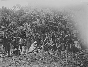 Kayan people (Borneo) - A European man discussing with the leaders of the Kayan people in Sarawak, circa 1900 to 1940.
