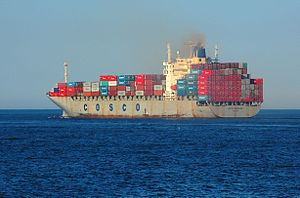 Shipping industry of China - A COSCO container ship sails from Boston Harbor.