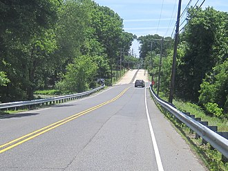 County Route 524 (New Jersey) - CR 524 eastbound curves to the right while the old alignment of the road prior to the construction of the Garden State Parkway continues straight ahead as a concrete road in Wall Township.