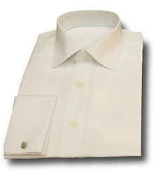 27bb168e A folded white dress shirt with French double cuffs.