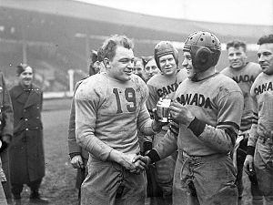 Comparison of American and Canadian football - In 1944, Canadian and American teams played an exhibition game at White City Stadium in London, United Kingdom. The Canadian Mustangs defeated the U.S. Pirates 16–6. Here, captains Frank Dombrowski (left) of the United States and W. Drinkwater of Canada shake hands.