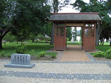 Canberra-Nara park with Kasuga stone lanterns framed by the gate Canberra Nara park.JPG