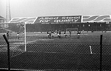A black and white image of a football match.