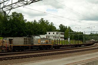 NSB Di 8 - Di 8.708 hauling a timber train at Hønefoss Station