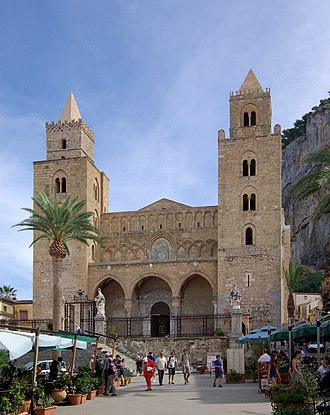 Cefalù - Two strong matching towers flank the cathedral porch, which has three arches (rebuilt around 1400) corresponding to the nave and the two aisles.