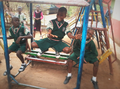 Children playing and laughing on a swing 01.png