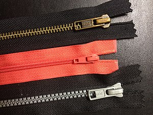 Zipper - Zippers with common teeth variations: metal teeth (top), coil teeth and plastic teeth.