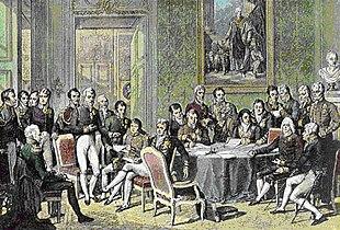 Delegierte des Wiener Kongresses in einem zeitgenössischen Kupferstich (koloriert) von Jean Godefroy nach dem Gemälde von Jean-Baptiste Isabey (Quelle: Wikimedia)