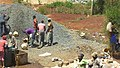 Construction site workers loading water, sand, ballast and cememt into a concrete mixer in Embu, Kenya 3.jpg