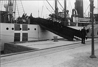 HMS E13 - E13 crew killed in action being borne aboard SS Vidar for repatriation.