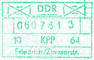 Checkpoint Charlie - Admission stamp applied to a passport at the East German (DDR) Friedrich/ Zimmerstraße crossing at Checkpoint Charlie. (1964)
