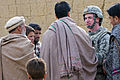 Defense.gov News Photo 101229-F-5160B-195 - U.S. Air Force Capt. Seth Platt meets with locals during a site survey for the proposed Abdul Hadi Padar secondary school in the Nijrab valley of.jpg