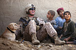 Defense.gov News Photo 111122-M-MM918-004 - U.S. Marine Corps Lance Cpl. Isaiah Schult an improvised explosive device dog handler jokes with Afghan children and an Afghan National Police.jpg