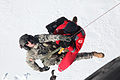 Defense.gov News Photo 120223-A-OD503-092 - U.S. Army Sgt. Joseph Campbell assigned to Charlie Company 1st Battalion 214th Aviation Regiment helps lift Darko Nisavic a doctor with a.jpg