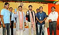 Dharmendra Pradhan and the Minister of State for Heavy Industries & Public Enterprises, Shri Babul Supriyo displaying how mobile apps are downloaded and utilized for digital transactions, during the DigiDhan Mela, at Puri.jpg