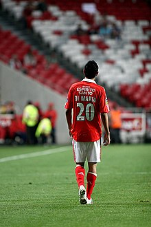 Player in red, walking away from the camera