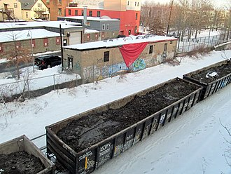 """Wynn Boston Harbor - """"Dirty dirt"""" train carrying contaminated soil from the construction site for disposal elsewhere, photographed in February 2017"""