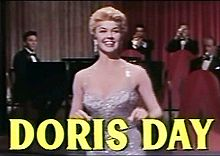 L'actriz, cantaire y productora estatounitense Doris Day en una imachen d'a cinta Love Me or Leave Me (1955).