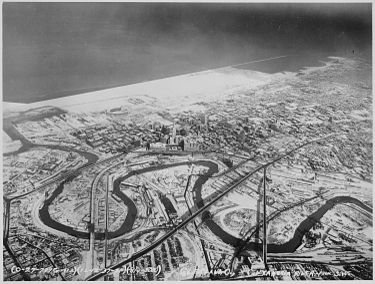 The Cuyahoga River winds through the Flats in a December 1937 aerial view of Downtown Cleveland. Downtown Cleveland, Ohio, in winter, from the air, 12-1937 - NARA - 512842.jpg