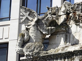 Monument to the Great Fire of London - Dragons sculpture on the side of the Monument