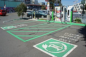 Plug-in hybrids in California - Public charging stations in a parking lot in San Francisco.