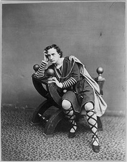 An old black and white photograph of the actor Edwin Booth in costume as Hamlet looking pensive.