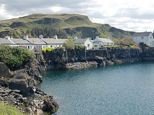 Eilean-a-beithich - Cottages in the village of Ellenabeich perched on the inner rim of the flooded quarry.