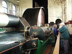 Ellenroad Ring Mill Engine - Alexandra, one of the twin preserved steam engines showing the rope drive flywheel