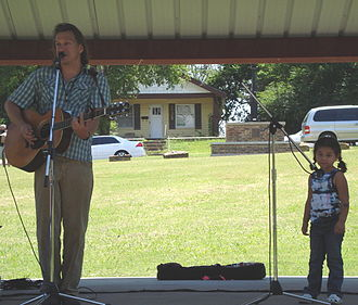 Ellis Paul - Paul is joined on stage by a young fan while performing at the Children's Festival at the 2008 Woody Guthrie Folk Festival - July 12, 2008.
