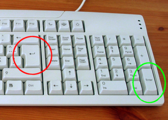 Enter key - Return (red/left circle) and Enter (green/right circle) buttons on a keyboard.
